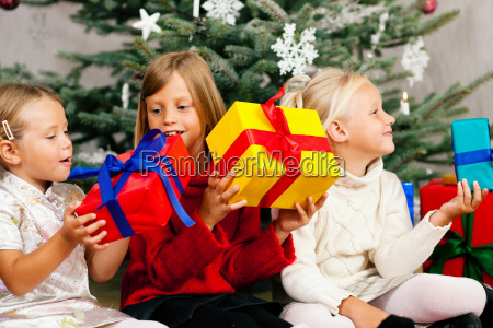 christmas children with gifts