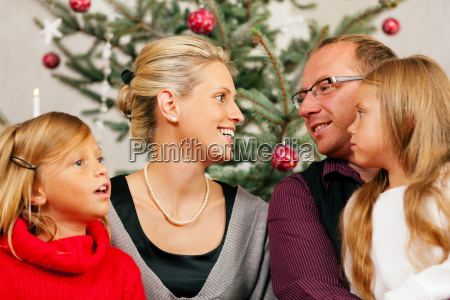 family in front of the christmas