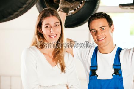 car mechanic repairing car of woman