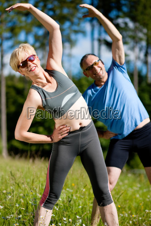senior couple doing sports in nature