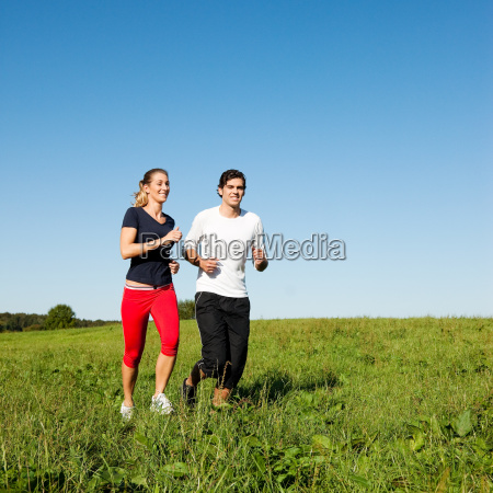sports couple is jogging in the