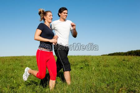 sport couple jogging in summer