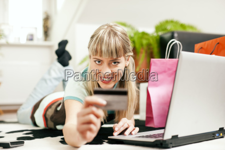 woman is shopping online on the