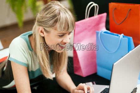 woman goes online in internet shopping