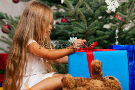 child with gifts for christmas