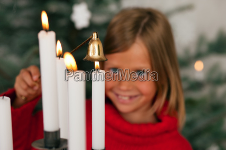 child deletes christmas candles