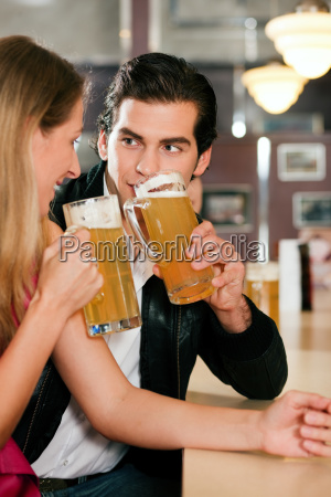 couple in a bar drinking beer