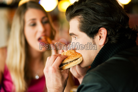 couple in the restaurant is eating