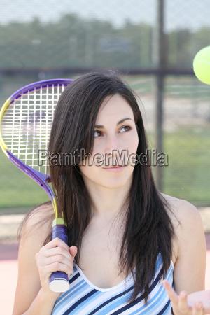 hispanic woman tennis racket ball