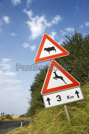 signs on a rural road in