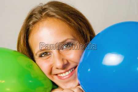 pretty woman with colorful balloons