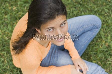 teenage girl sitting in a park