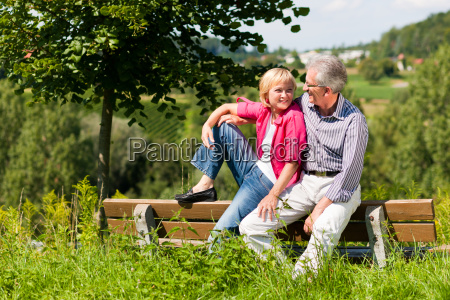 elderly couple on a bench in