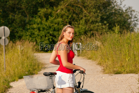 woman with bicycle in summer