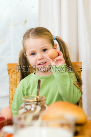 family little girl while eating