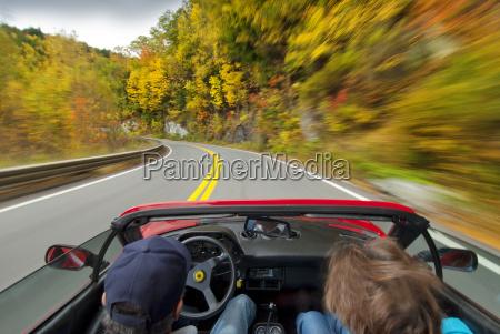 fall foliage drive in sports car
