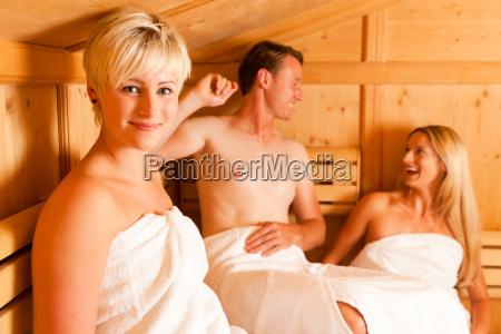 three people in sauna