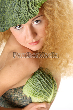 woman with savoy cabbage leaf