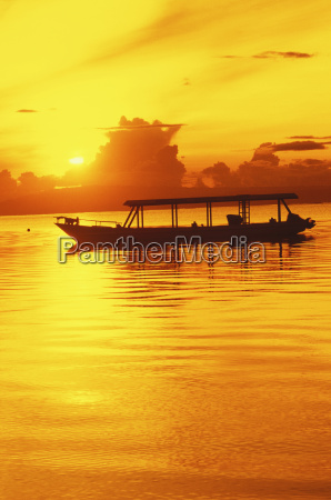 silhouette of a boat in the