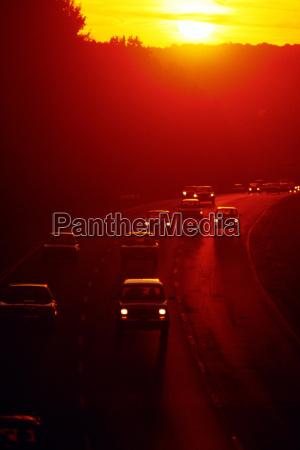traffic along i 495 at sunset