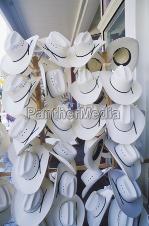 cowboy hats hanging in a hat