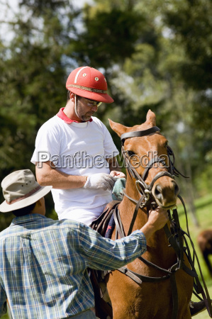 mature man sitting on a horse