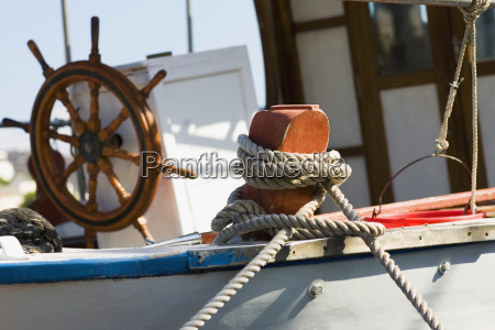 boat tied up with a rope