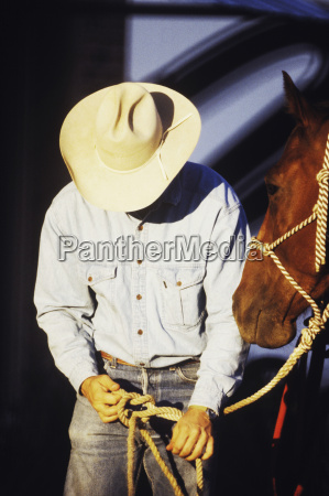 close up of a cowboy tying