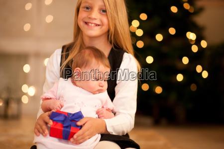 girl and baby at christmas