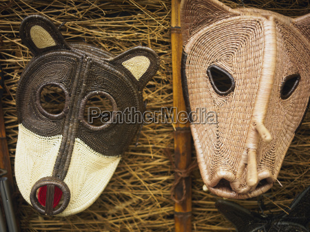 close up of two masks old