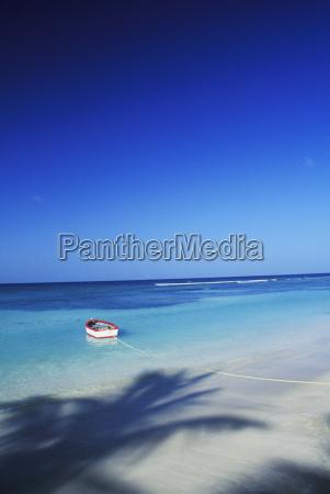 rowboat moored on the beach caribbean