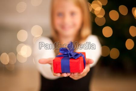 girl with gift at christmas