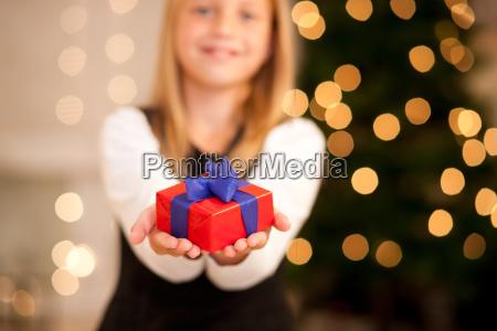 girl with present at christmas