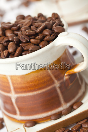 coffee beans in ceramic cup