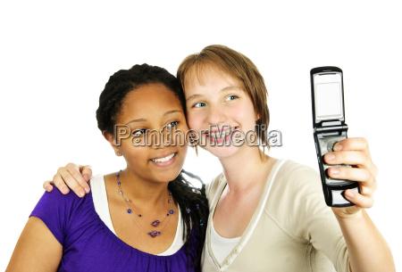 teen girls with camera phone