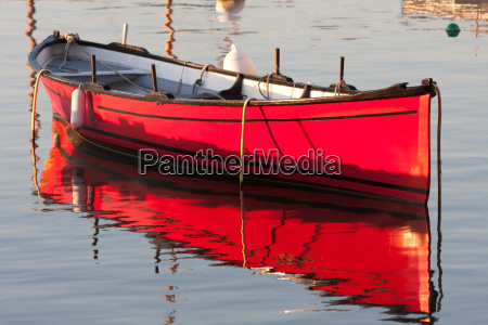 morning light on a red boat