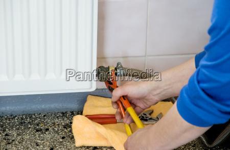 hands of a plumber repairman