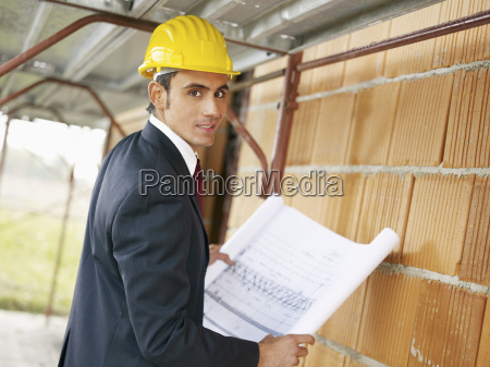 architect with building plans