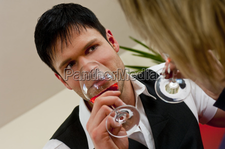relaxed man with wineglass