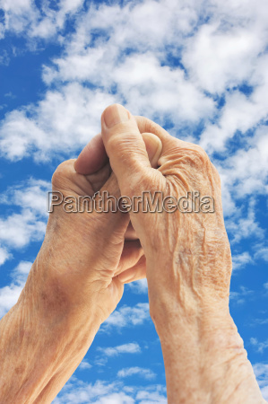 senior woman hands over blue