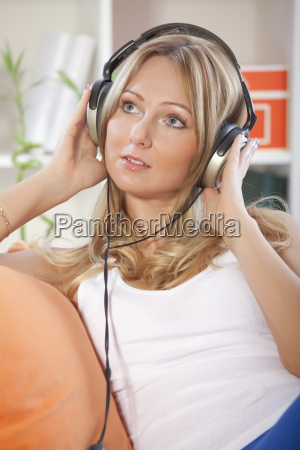 woman listening music at home