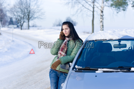 winter car breakdown woman call
