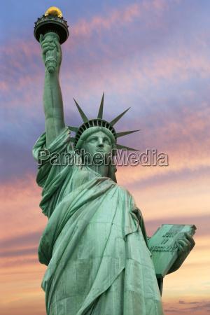statue of liberty under a vivid