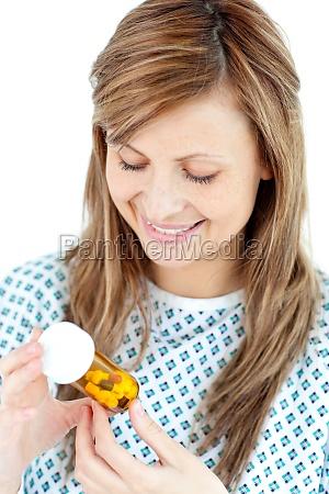 krank junge frau mit pillen