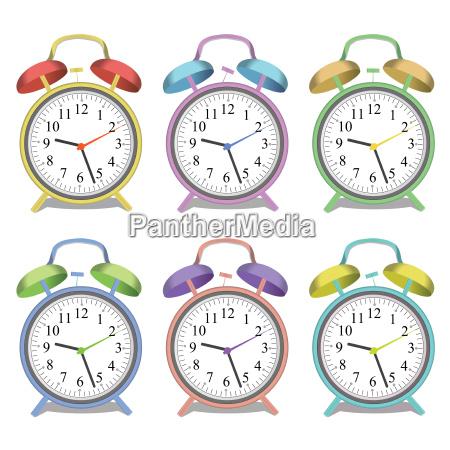 image of various colorful alarm clocks