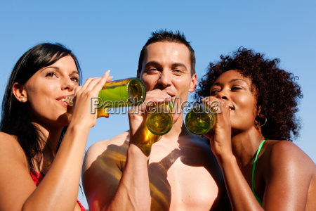 friends drinking beer in a summer