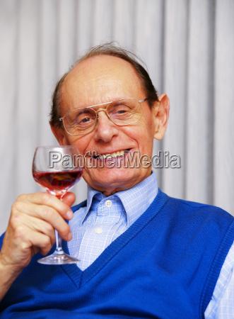 senior drinking wine senior beim