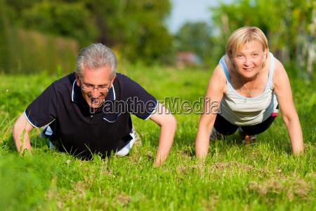 oap couple doing pushups