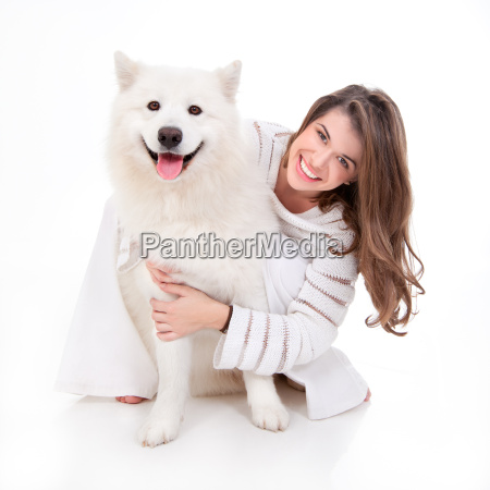 woman with white dog smiling