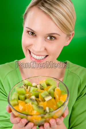 healthy lifestyle woman holding fruit